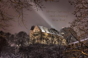 Picture of the Imperial Castle through winterly trees with the words Merry Christmas and a happy New Year in the sky