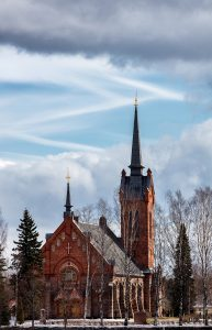 Church of Eura in front of a partly cloudy sky