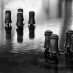 Nozzles of a fountain at night in black and white