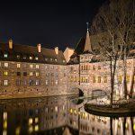 Buildings at a river at night