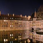 Panorama of a buildings at a river at night