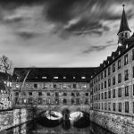 Old building over a river at night in black and white