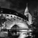 Historic building and Kettensteg at night in black and white