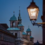 Old town hall with a lantern in the foreground