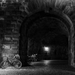 Gate in black and white at night