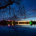 Panorama twilight over a lake to a funfair