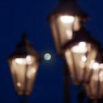 Moon between lanterns at night